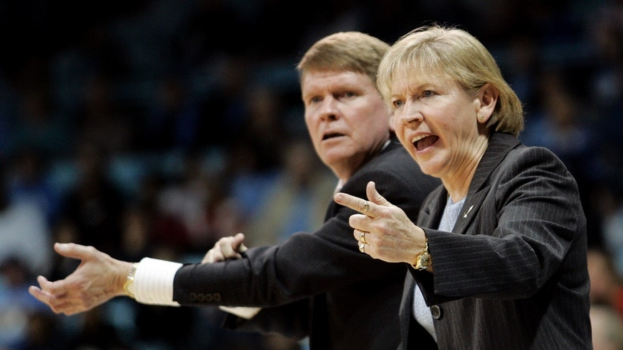 FILE - In this Jan. 17, 2010 file photo, North Carolina head coach Sylvia Hatchell, right, and associate head coach Andrew Calder instructs their team during the second half of an NCAA college basketball game against Maryland in Chapel Hill, N.C. Hatchell, in a release from the school on Monday, Oct. 14, 2013, said she would temporarily step away from her coaching duties to focus on treatment for leukemia. Now it's up to longtime assistant Calder to keep things running smoothly until Hatchell can return. (AP Photo/Jim R. Bounds, File)