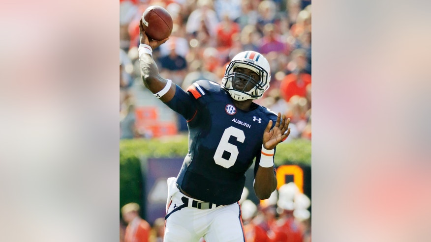 Auburn quarterback Jeremy Johnson (6) throws a first down during the first half of an NCAA college football game against Western Carolina in Auburn, Ala., Saturday, Oct. 12, 2013. (AP Photo/Dave Martin)