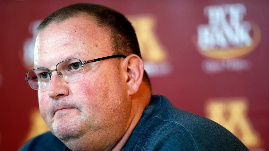 Minnesota defensive coordinator Tracy Claeys attends a news conference Thursday, Oct. 10, 2013, in Minneapolis. Claeys is taking over as acting coach as coach Jerry Kill has taken an open-ended leave of absence from the team to focus on treatment and management of his epilepsy. (AP Photo/Star Tribune, Carlos Gonzalez) ST. PAUL OUT  MINNEAPOLIS-AREA TV OUT  MAGS OUT
