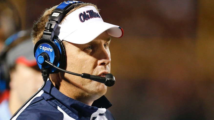 Mississippi football coach Hugh Freeze watches as his team plays Texas A&M in the second half of their NCAA college football game at Vaught-Hemingway Stadium in Oxford, Miss., Saturday, Oct. 12, 2013. No. 9 Texas A&M won 41-38. (AP Photo/Rogelio V. Solis)