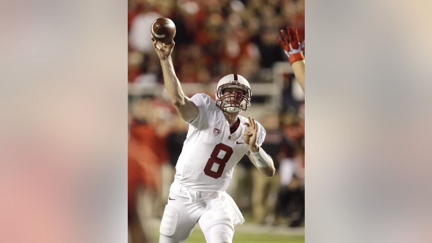 Stanford quarterback Kevin Hogan (8) passes the ball during the fourth quarter of an NCAA college football game against Utah on Saturday, Oct. 12, 2013, in Salt Lake City. (AP Photo/Rick Bowmer)