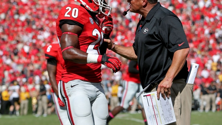 Georgia defensive back Quincy Mauger (20) gets an earful from defensive coordinator Todd Grantham after a Missouri touchdown late in their NCAA college football game game at Sanford Stadium Saturday, Oct. 12, 2013. in Athens, Ga. (AP Photo/Atlanta Journal-Constitution, Jason Getz)  MARIETTA DAILY OUT; GWINNETT DAILY POST OUT; LOCAL TV OUT; WXIA-TV OUT; WGCL-TV OUT