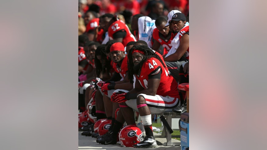 Georgia linebacker T.J. Stripling (44) and other members of the defense sit on the sideline late in their NCAA college football game game against Missouri at Sanford Stadium Saturday, Oct. 12, 2013. in Athens, Ga. (AP Photo/Atlanta Journal-Constitution, Jason Getz)  MARIETTA DAILY OUT; GWINNETT DAILY POST OUT; LOCAL TV OUT; WXIA-TV OUT; WGCL-TV OUT