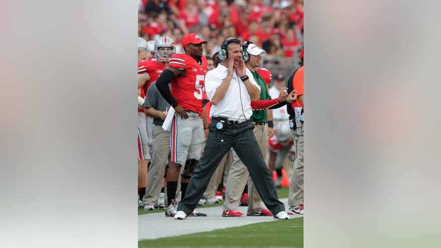 FILE - In this Sept. 7, 2013, file photo, Ohio State head coach Urban Meyer watches from the sidelines during an NCAA college football game against San Diego State in Columbus, Ohio.  It's only natural that as No. 4 Ohio State's winning streak keeps building, so does the pressure. Some of the Buckeyes say they don't even notice, but others are aware that at 18 and counting the streak and its accompanying drama is mounting. (AP Photo/Jay LaPrete, File)