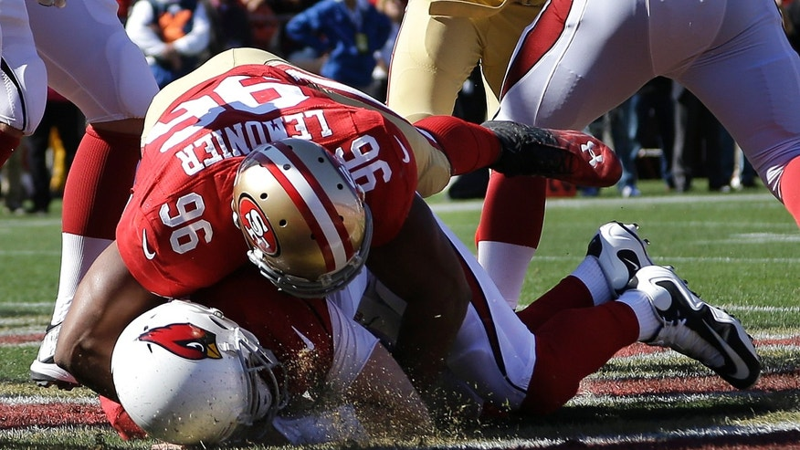 San Francisco 49ers linebacker Corey Lemonier (96) sacks Arizona Cardinals quarterback Carson Palmer for a safety during the second quarter of an NFL football game in San Francisco, Sunday, Oct. 13, 2013. (AP Photo/Ben Margot)