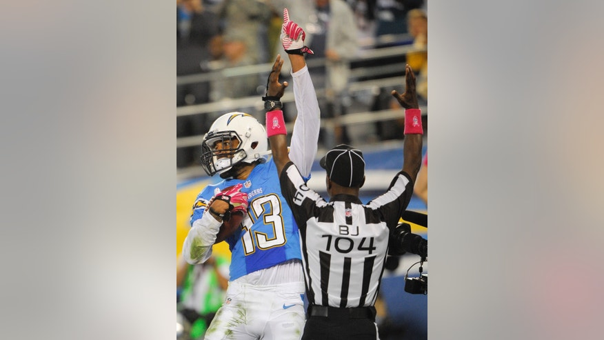 San Diego Chargers wide receiver Keenan Allen, left, celebrates his touchdown against the Indianapolis Colts during the first half of an NFL football game Monday, Oct. 14, 2013, in San Diego. (AP Photo/Denis Poroy)