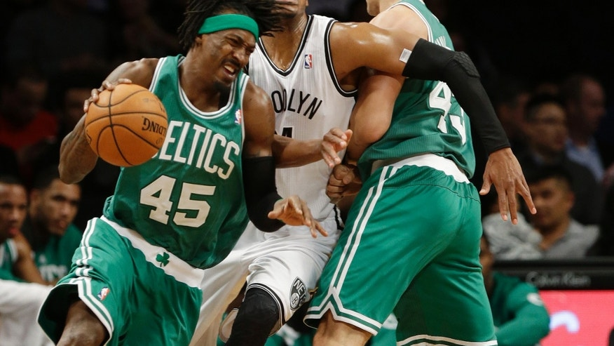 Brooklyn Nets' Paul Pierce (34) fights off a pick by Boston Celtics' Kris Humphries (43) as he defends against Boston's Gerald Wallace (45) during the first half of a preseason NBA basketball game Tuesday, Oct. 15, 2013, in New York. (AP Photo/Frank Franklin II)