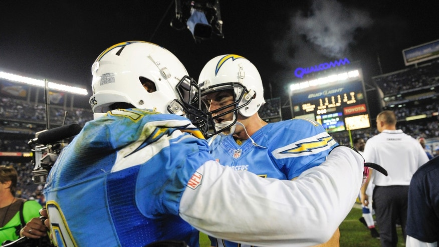 San Diego Chargers quarterback Philip Rivers, right, and  wide receiver Keenan Allen,left, celebrate after the Chargers' 19-9 victory in a NFL football game Monday, Oct. 14, 2013, in San Diego.  (AP Photo/Denis Poroy)