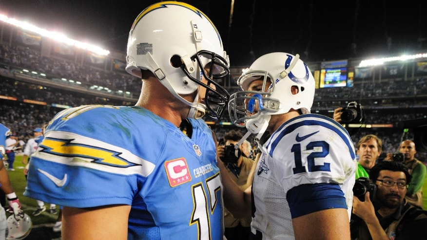Indianapolis Colts quarterback Andrew Luck, right, and San Diego Chargers quarterback Philip Rivers talk after the Chargers' 19-9 victory in a NFL football game Monday, Oct. 14, 2013, in San Diego.  (AP Photo/Denis Poroy)