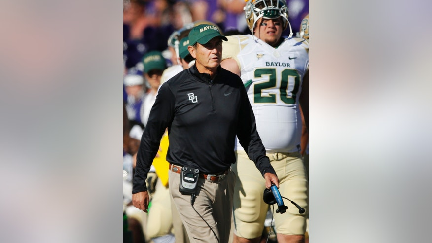 Baylor coach Art Briles walks the sideline during the first half of an NCAA college football game against Kansas State in Manhattan, Kan., Saturday, Oct. 12, 2013. (AP Photo/Orlin Wagner)
