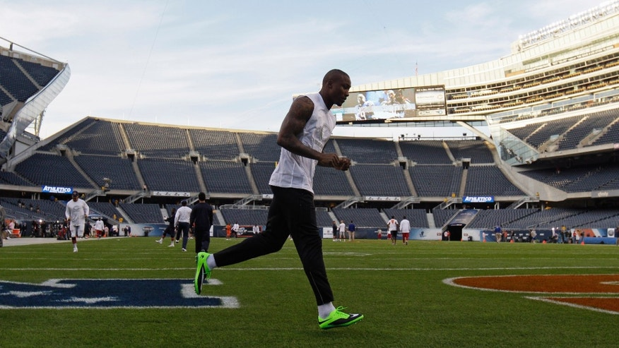 Chicago Bears wide receiver Brandon Marshall jogs on the field during warm-ups before an NFL football game against the New York Giants, Thursday, Oct. 10, 2013, in Chicago. (AP Photo/Nam Y. Huh)
