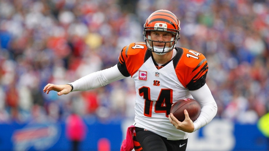 Cincinnati Bengals quarterback Andy Dalton (14) scrambles in the first quarter of the NFL football game against the Buffalo Bills, Sunday, Oct. 13, 2013, in Orchard Park, N.Y. (AP Photo/Bill Wippert)
