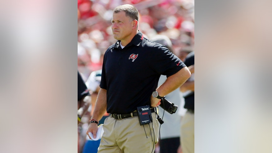FILE - In this Sept. 29, 2013, file photo, Tampa Bay Buccaneers head coach Greg Schiano watches from the sideline during the second half of an NFL football game against the Arizona Cardinals in Tampa, Fla. Before Schiano became Tampa Bay's head coach, Chip Kelly turned down the Buccaneers. Kelly also turned down the Browns and Eagles a year later before changing his mind and leaving Oregon. When the Buccaneers and Eagles meet Sunday, the two coaches will be on opposite sidelines.  (AP Photo/Reinhold Matay, File)