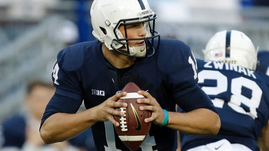Penn State quarterback Christian Hackenberg (14) looks to pass during the second quarter of an NCAA college football game against Michigan in State College, Pa., Saturday, Oct. 12, 2013. (AP Photo/Gene J. Puskar)