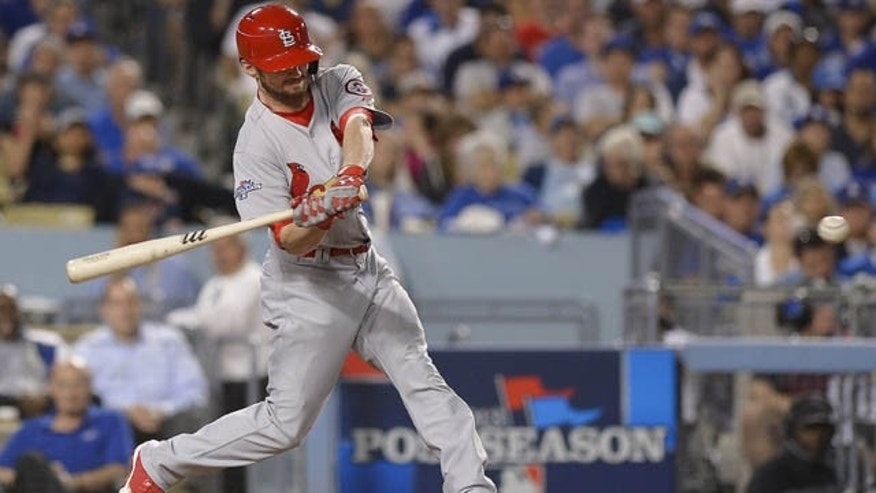 October 15, 2013: St. Louis Cardinals' Shane Robinson hits a home run during the seventh inning of Game 4 of the National League baseball championship series against the Los Angeles Dodgers Tuesday. (AP Photo/Mark J. Terrill)