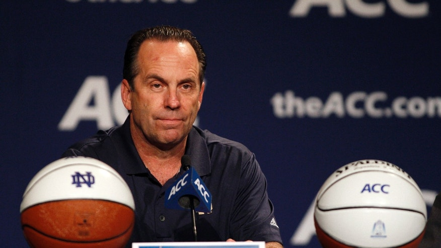 Notre Dame basketball coach Mike Brey answers a question at a news conference during the NCAA college Atlantic Coast Conference media day in Charlotte, N.C., Wednesday, Oct. 16, 2013. (AP Photo/Nell Redmond)