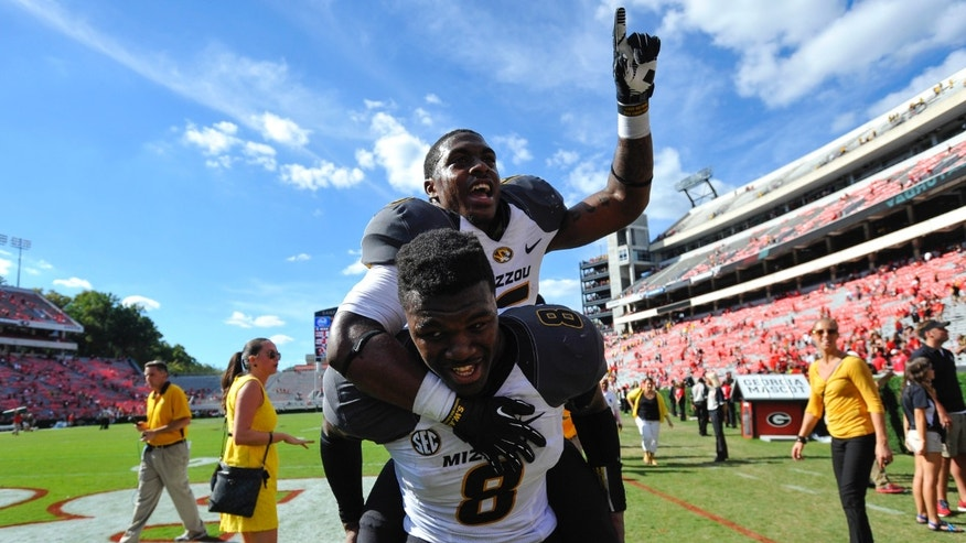 Missouri running back Marcus Murphy (6) gets a piggy back ride from wide receiver Darius White (8) while celebrating after their 41-26 win over Georgia in an NCAA college football game against Missouri Saturday, Oct. 12, 2013 in Athens, Ga. (AP Photo/Athens Banner-Herald, AJ Reynolds)  MAGS OUT; MANDATORY CREDIT