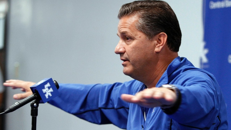 Kentucky coach John Calipari answers a reporter's question during the NCAA men's college basketball team's media day Tuesday, Oct. 15, 2013, in Lexington, Ky. (AP Photo/James Crisp)