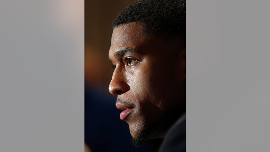 Missouri player Ernest Ross talks with reporters during Southeastern Conference NCAA college basketball media day in Birmingham, Ala., Wednesday, Oct. 16, 2013. (AP Photo/Dave Martin)