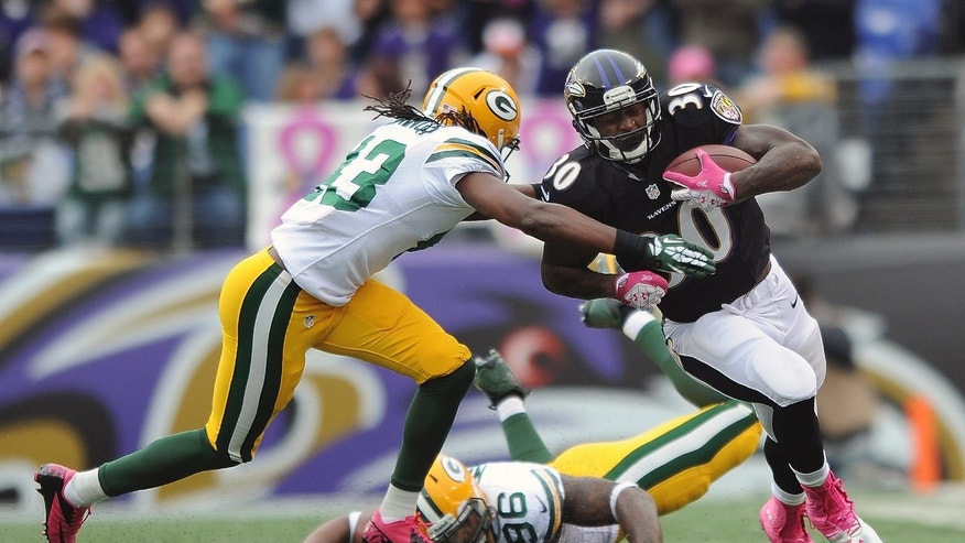 Baltimore Ravens running back Bernard Pierce (30) is tackled by Green Bay Packers free safety M.D. Jennings as defensive end Mike Neal (96) lies on the ground during the first half of an NFL football game in Baltimore, Sunday, Oct. 13, 2013. (AP Photo/Gail Burton)