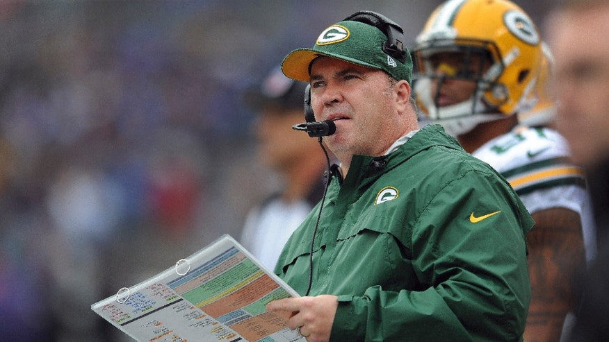 Green Bay Packers head coach Mike McCarthy looks up at the scoreboard during the first half of an NFL football game against the Baltimore Ravens in Baltimore, Sunday, Oct. 13, 2013. (AP Photo/Gail Burton)