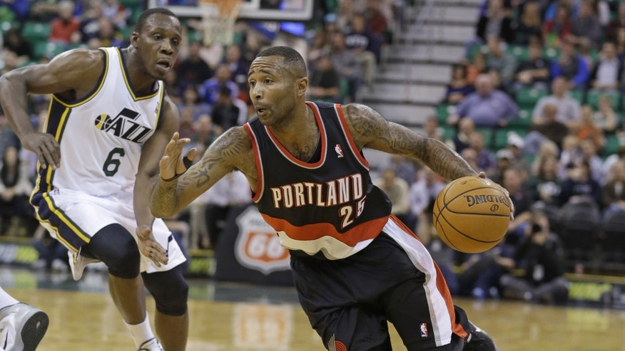 Portland Trail Blazers' Mo Williams (25) drives past Utah Jazz's Lester Hudson (6) during the second quarter of an NBA preseason basketball game Wednesday, Oct. 16, 2013, in Salt Lake City. (AP Photo/Rick Bowmer)