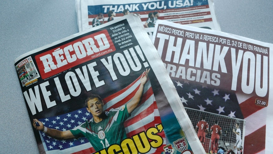 Mexican newspaper front pages carry messages of thanks to the U.S. in Mexico City, Wednesday, Oct. 16, 2013.