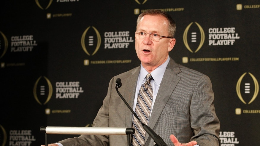Arkansas athletic director Jeff Long, chairman of College Football Playoff selection committee, responds to questions during a news conference where the 12 members selected to the committee were announced, Wednesday, Oct. 16, 2013, in Irving, Texas. Former Secretary of State Condoleezza Rice, former Nebraska coach Tom Osborne and College Football Hall of Fame quarterback Archie Manning along with Long, are among the 13 people who will be part of the College Football Playoff selection committee in 2014. (AP Photo/Tony Gutierrez)
