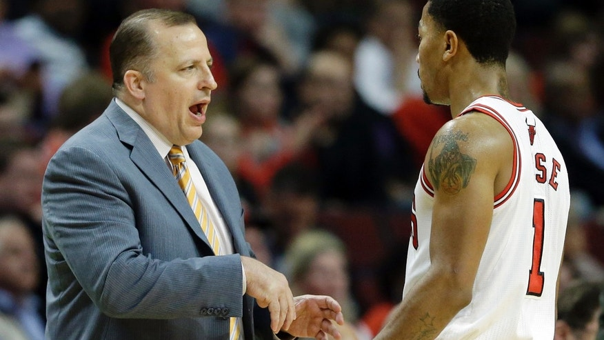 Chicago Bulls head coach Tom Thibodeau, left, talks with guard Derrick Rose during the first half of an NBA preseason basketball game against the Detroit Pistons in Chicago on Wednesday, Oct. 16, 2013. (AP Photo/Nam Y. Huh)