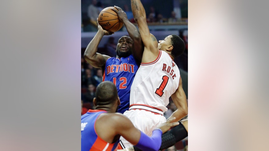 Detroit Pistons guard Will Bynum (12) shoots as Chicago Bulls guard Derrick Rose guards during the first half of an NBA preseason basketball game in Chicago on Wednesday, Oct. 16, 2013. (AP Photo/Nam Y. Huh)
