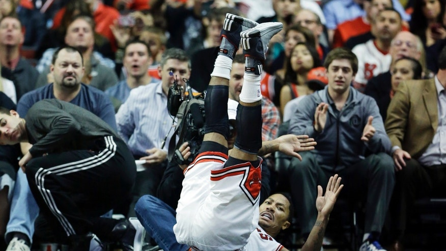 Chicago Bulls guard Derrick Rose falls down during the first half of an NBA preseason basketball game against the Detroit Pistons in Chicago on Wednesday, Oct. 16, 2013. (AP Photo/Nam Y. Huh)