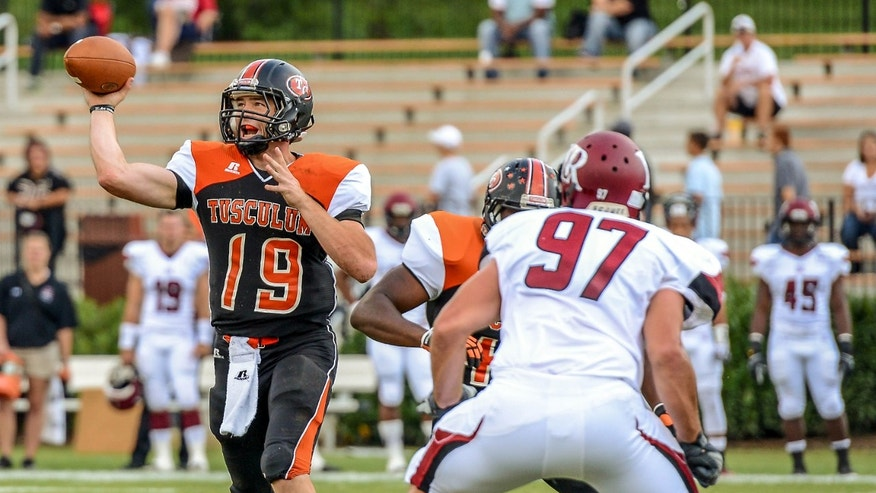 In a Sept. 28. 2013, photo provided by Tusculum College, quarterback Bo Cordell (19) passes as Lenoir-Rhyne defensive end Blake Baker (97) rushes in an NCAA college football game in Greeneville, Tenn. Cordell wasn't considered big enough or fast enough to get offers from major college programs. So he went to tiny Tusculum College instead and now is on the verge of setting an NCAA Division II record for career yards passing. (AP Photo/Tusculum College)