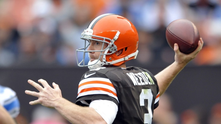 Cleveland Browns quarterback Brandon Weeden passes against the Detroit Lions in the fourth quarter of an NFL football game Sunday, Oct. 13, 2013 in Cleveland. (AP Photo/David Richard)