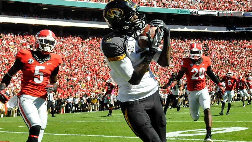 Missouri wide receiver L'Damian Washington (2) makes a catch for a touchdown while defended by Georgia cornerback Damian Swann (5) and defensive back Quincy Mauger (20) during the first half of an NCAA college football game Saturday, Oct. 12, 2013, in Athens, Ga. (AP Photo/Athens Banner-Herald, AJ Reynolds)  MAGS OUT; MANDATORY CREDIT