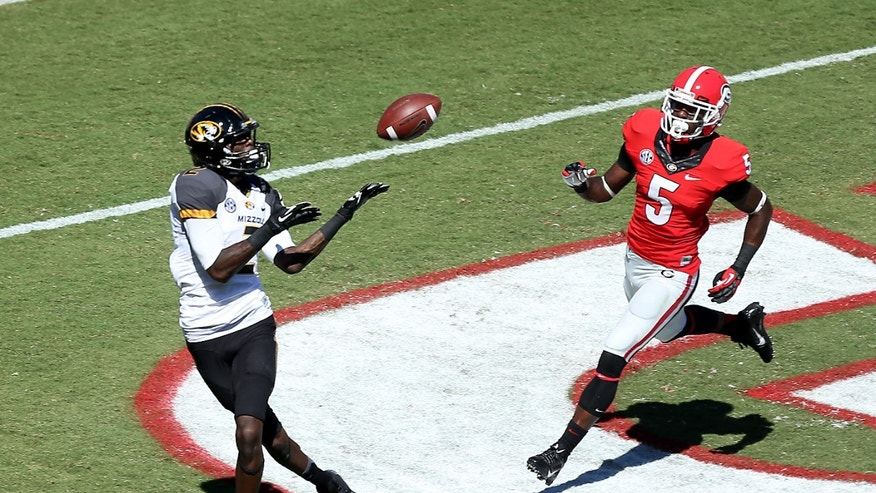 Missouri wide receiver L'Damian Washington (2) makes a 16-yard touchdown catch in front of Georgia cornerback Damian Swann (5) in the first half of of an NCAA college football game game at Sanford Stadium Saturday, Oct. 12, 2013. in Athens, Ga. (AP Photo/Atlanta Journal-Constitution, Jason Getz)  MARIETTA DAILY OUT; GWINNETT DAILY POST OUT; LOCAL TV OUT; WXIA-TV OUT; WGCL-TV OUT