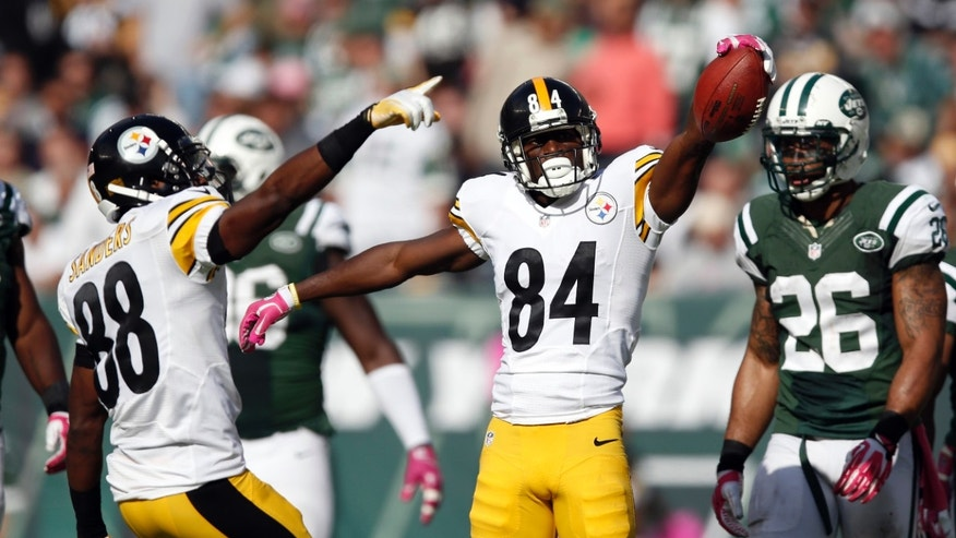 Pittsburgh Steelers wide receiver Antonio Brown (84) and teammate Emmanuel Sanders (88) react after a catch during the second half of an NFL football game against the New York Jets, Sunday, Oct. 13, 2013, in East Rutherford, N.J. The Steelers won 19-6. (AP Photo/Kathy Willens)
