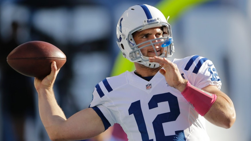 Indianapolis Colts quarterback Andrew Luck warms up before playing the San Diego Chargers in an NFL football game Monday, Oct. 14, 2013, in San Diego. (AP Photo/Lenny Ignelzi)