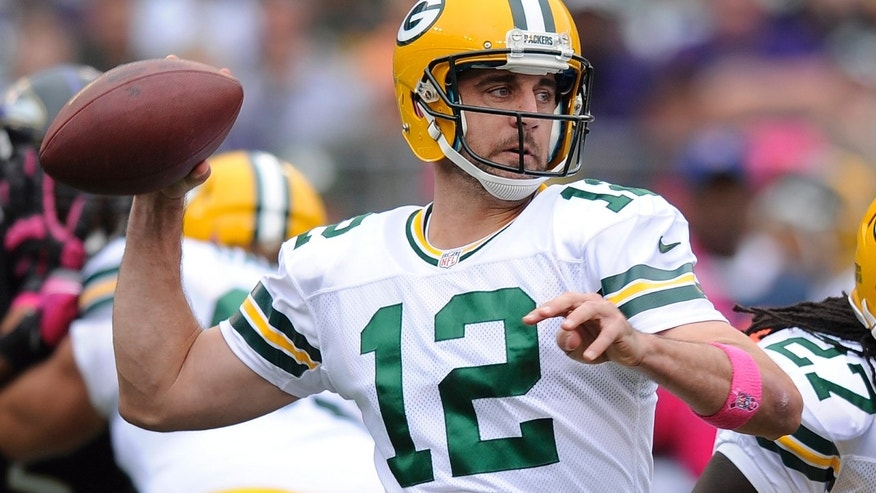 Green Bay Packers quarterback Aaron Rodgers winds up to pass during the first half of a NFL football game against Baltimore Ravens in Baltimore, Sunday, Oct. 13, 2013. (AP Photo/Nick Wass)