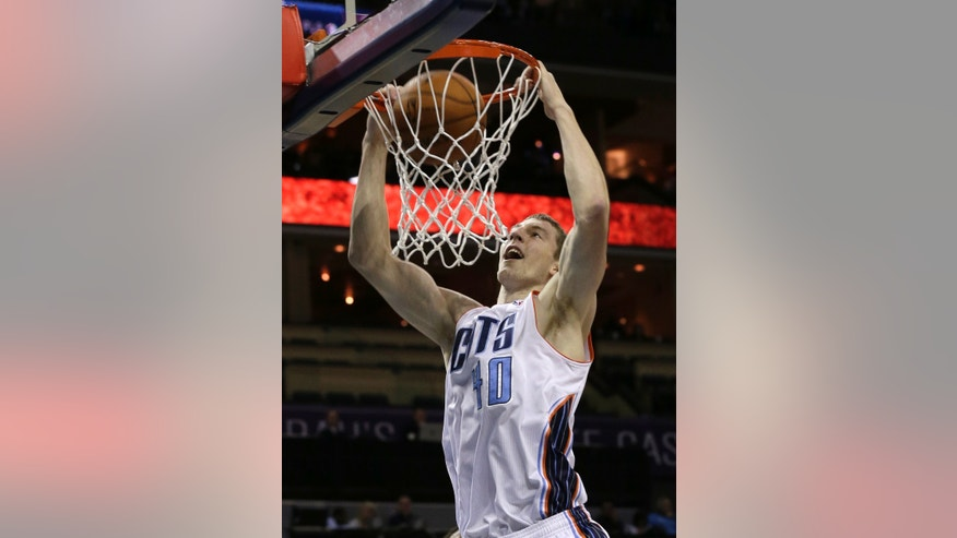 Charlotte Bobcats' Cody Zeller dunks against the Philadelphia 76ers during the first half of a preseason NBA basketball game in Charlotte, N.C., Thursday, Oct. 17, 2013. (AP Photo/Chuck Burton)