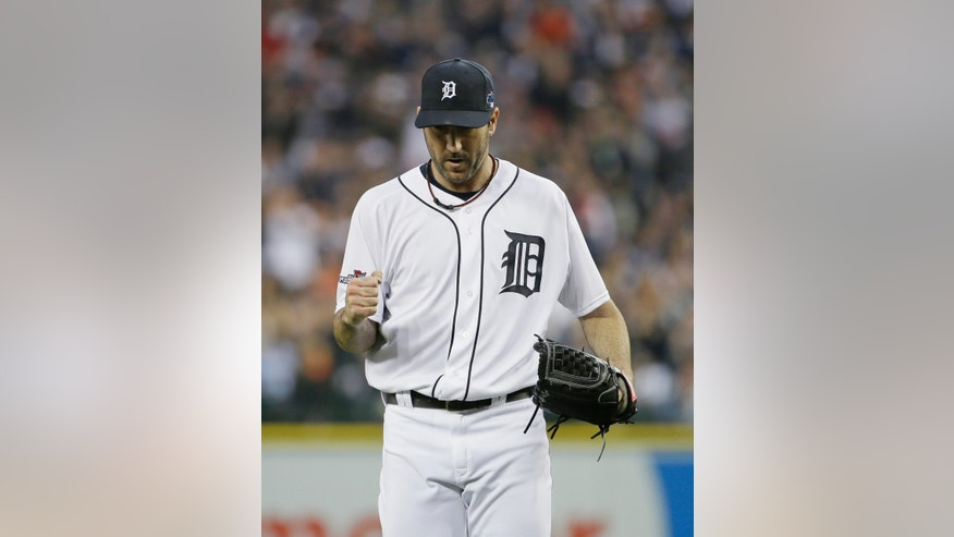 Detroit Tigers starting pitcher Justin Verlander reacts after Boston Red Sox's Dustin Pedroia grounds out to end the sixth inning during Game 3 of the American League baseball championship series Tuesday, Oct. 15, 2013, in Detroit. (AP Photo/Matt Slocum)
