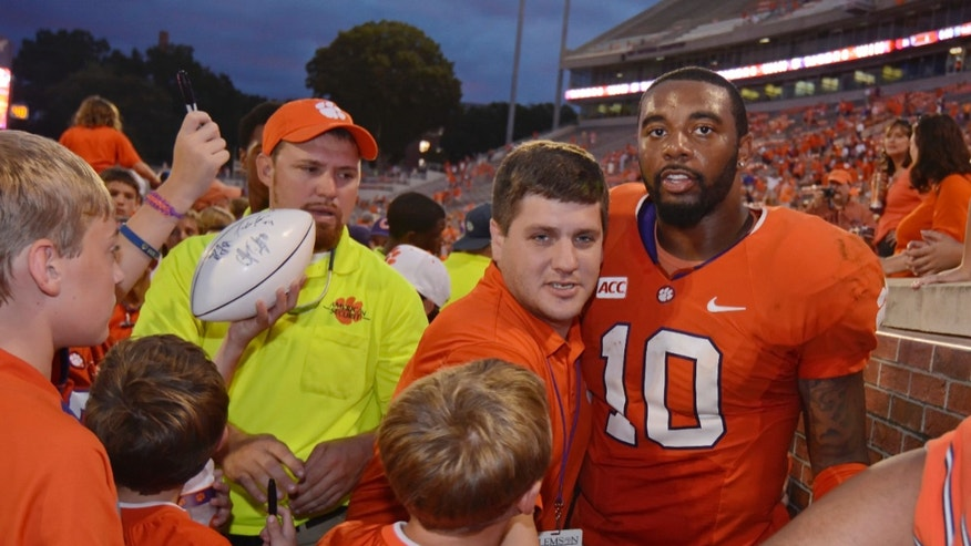 Clemson quarterback Tajh Boyd (10) is surrounded by fans while being escorted off of the field after defeating Boston College 24-14 in an NCAA college football game on Saturday, Oct. 12, 2013, at Memorial Stadium in Clemson, S.C. (AP Photo/ Richard Shiro)
