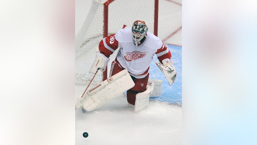Detroit Red Wings goalie Jonas Gustavsson, of Sweden, makes a save in the first period of an NHL hockey game against the Colorado Avalanche on Thursday, Oct. 17, 2013, in Denver. (AP Photo/Chris Schneider)