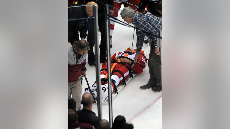 Detroit Red Wings defenseman Niklas Kronwall, of Sweden, is taken off the ice on a stretcher after being checked against the boards in the first period of an NHL hockey game against the Colorado Avalanche on Thursday, Oct. 17, 2013, in Denver. (AP Photo/Chris Schneider)
