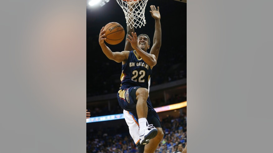 New Orleans Pelicans guard Brian Roberts (22) goes up for a shot in front of Oklhaoma City Thunder forward Serge Ibaka in the second quarter of an NBA basketball preseason game in Tulsa, Okla., Thursday, Oct. 17, 2013. (AP Photo/Sue Ogrocki)