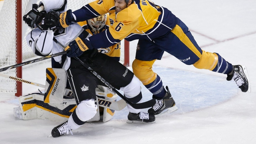 Nashville Predators defenseman Shea Weber (6) clears Los Angeles Kings right wing Dustin Brown, left, from in front of the net in the first period of an NHL hockey game Thursday, Oct. 17, 2013, in Nashville, Tenn. (AP Photo/Mark Humphrey)