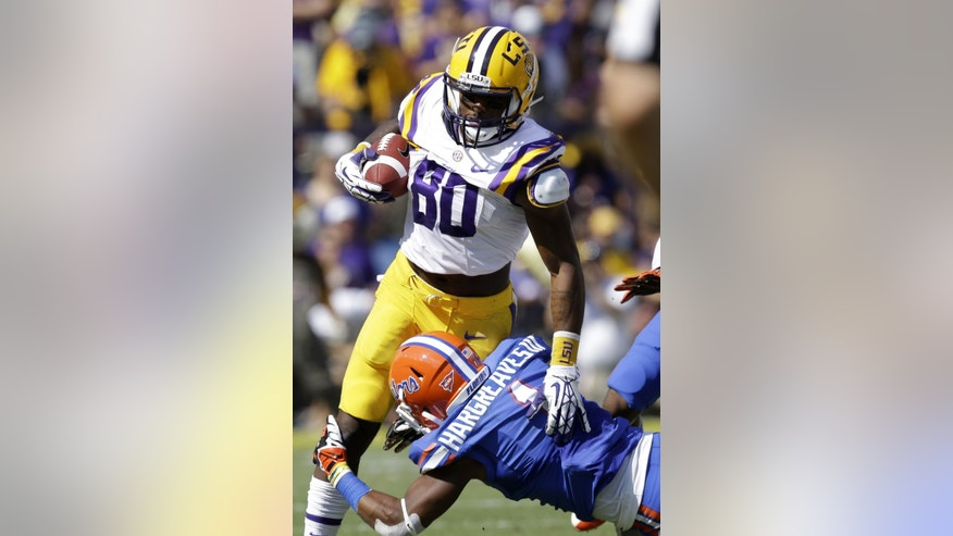 Florida defensive back Vernon Hargreaves III (1) tries to tackle LSU wide receiver Jarvis Landry (80) in the first half of an NCAA college football game in Baton Rouge, La., Saturday, Oct. 12, 2013. (AP Photo/Gerald Herbert)