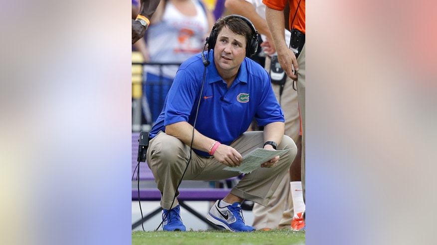 Florida head coach Will Muschamp watches from the sideline in the second half of an NCAA college football game against LSU in Baton Rouge, La., Saturday, Oct. 12, 2013.  LSU won 17-6. (AP Photo/Gerald Herbert)