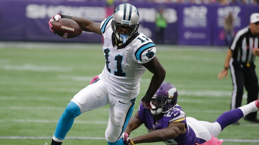Carolina Panthers wide receiver Brandon LaFell, left, breaks the tackle of Minnesota Vikings cornerback Xavier Rhodes on his way to the 1-yard line during the first half of an NFL football game in Minneapolis, Sunday, Oct. 13, 2013. (AP Photo/Jim Mone)