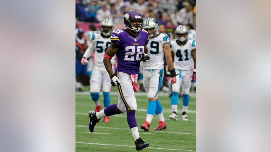 Minnesota Vikings running back Adrian Peterson leaves the field during the first half of an NFL football game against the Carolina Panthers in Minneapolis, Sunday, Oct. 13, 2013. One of the star running back's sons, a 2-year-old in South Dakota, died Friday after an alleged attack in a child abuse case.(AP Photo/Ann Heisenfelt)