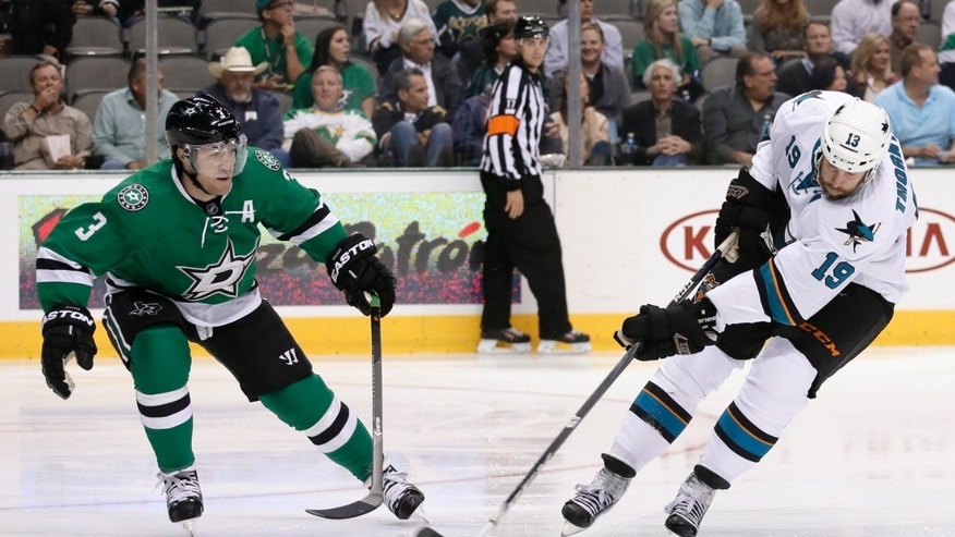 Dallas Stars defenseman Stephane Robidas (3) defends as San Jose Sharks center Joe Thornton (19) attempts a shot in the second period of an NHL hockey game, Thursday, Oct. 17, 2013, in Dallas. (AP Photo/Tony Gutierrez)